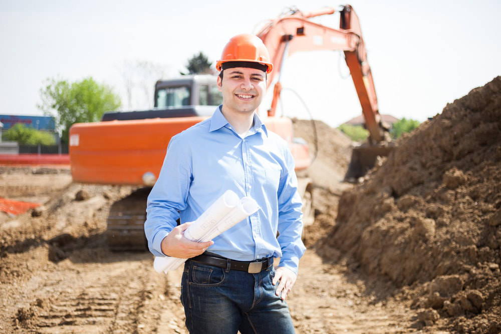 Groundworks team with site excavator