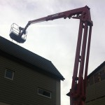 an image of a cherry picker above a building