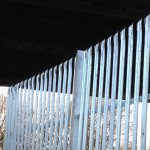 an image of a metal security fence