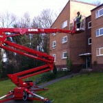 an image of a cherry picker outside a small block of flats