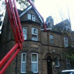 an image of a cherry picker being used to access the roof of a period home