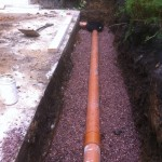 an image of a brown pipe underground