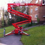 an image of the process of a cherry picker being extended
