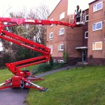 an image of a static cherry picker outside a residential building