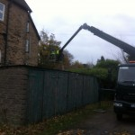 an image of a cherry picker truck gaining access to the wall of a building