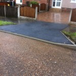 an image of a residential driveway that has recently been resurfaced