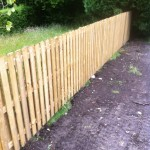 an image of a garden fence that has recently been put up