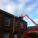 an image of a cherry picker used to allow a worker access to a chimney