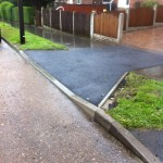 an image of a driveway that has recently been paved