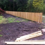 an image of wooden fence being erected
